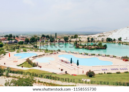 Swimming pool and Pamukkale town in Turkey #1158555730