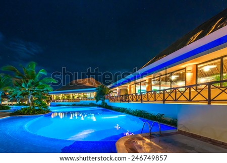 Swimming pool and restaurant at the luxury caribbean resort at night, dawn time. Mexico.