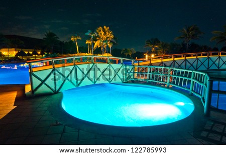 Swimming pool at a luxury caribbean resort at night, dawn time. Bahia Principe, Riviera Maya, Mexican Resort.