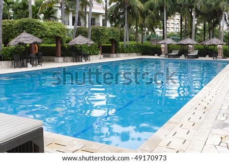 swimming pool at a summer resort in sanya, hainan island, china.