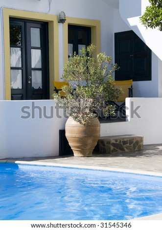 swimming pool at luxury greek island hotel with cyclades style arched architecture on island of santorini greece in the mediterranean sea, Imerovigli,