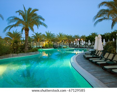 Swimming pool at night in France. Wide angle.