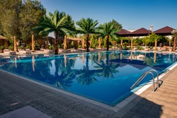 Swimming pool at the luxury tropical resort. Swimming pool with the some beach lounges at the luxury tropical resort.