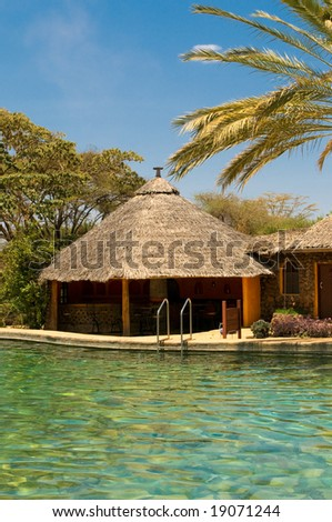 swimming pool, bungalow and palm