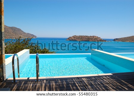 Swimming pool by luxury villa with a view on Spinalonga Island, Crete, Greece