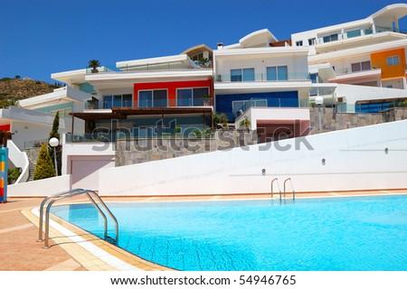 Swimming pool by luxury villas, Crete, Greece