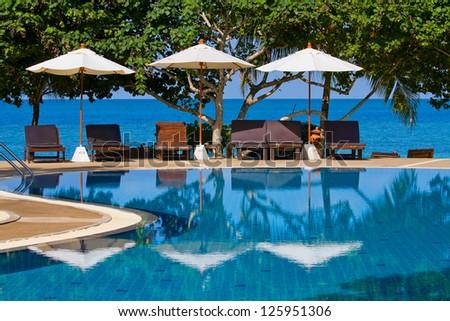Swimming pool by the sea on island Koh Phangan,Thailand - stock photo