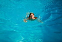 Swimming pool. Child swimmingpool. Kids summer holiday. Summertime attractions