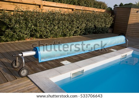 Swimming pool cover detail for protection and heat the water #533706643