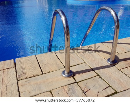 Swimming pool edge with steel handle bars