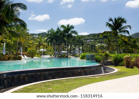 Swimming pool from beach on french side of St Martin Sint Maarten Caribbean - stock photo