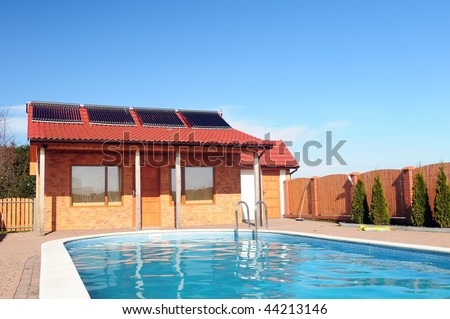 stock photo swimming pool in front of small bungalow with solar panels on roof 44213146 Solar Panels For Swimming Pools
