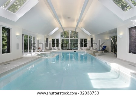 Swimming pool in luxury home - stock photo