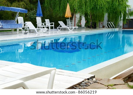 Swimming pool in the hotel with blue relaxing water