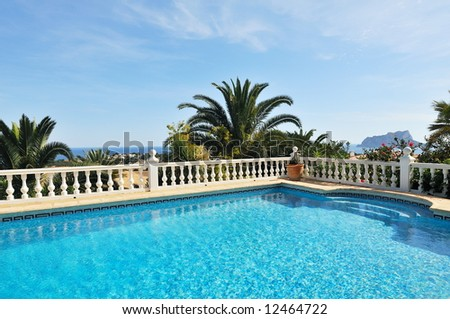 swimming pool in the yard of a luxury house with a spectacular view