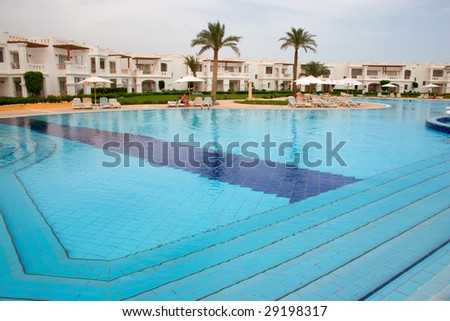 swimming pool in tropical hotel