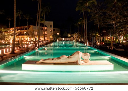 Swimming pool, night, hotel in thailand.