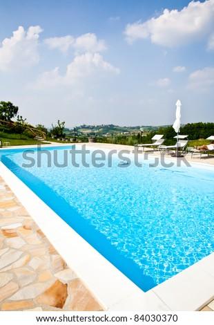 Swimming pool of an Italian beauty farm in the middle vineyards, Monferrato area, Piemonte region.