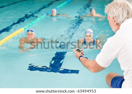 Swimming pool - swimmer training competition in class with coach - stock photo