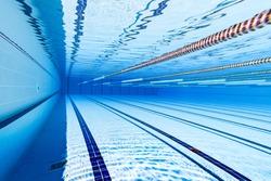 Swimming pool underwater blue background.