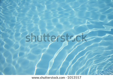 Swimming pool water with circular waves
