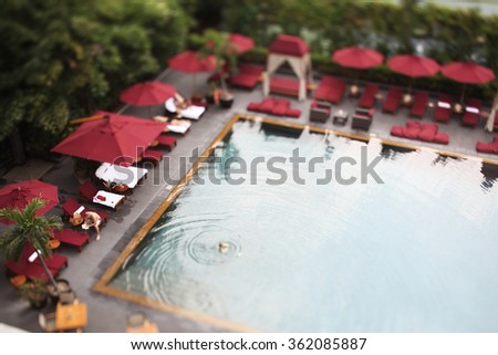 swimming pool with aerial view. tilt and shift lens effect - stock photo