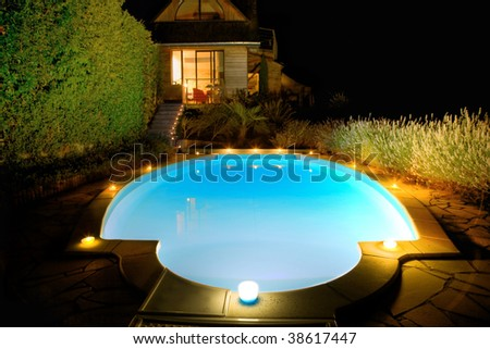 Swimming-pool with candles at night
