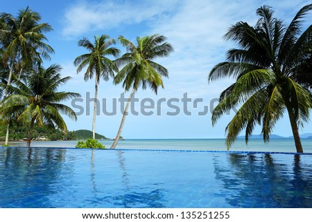 Swimming pool with coconut trees on the island Koh Mak, Trat