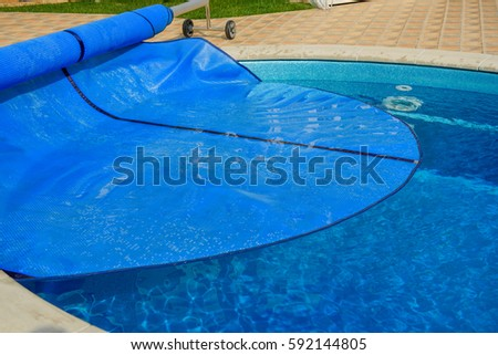 Swimming pool with cover from dirt and isolation. #592144805