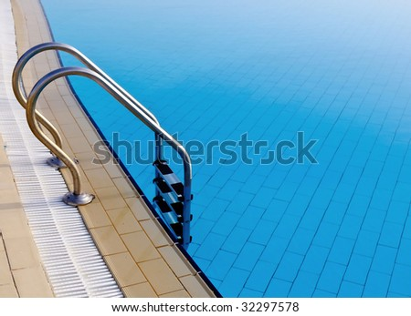 Swimming pool with ladder. Copy space for your text