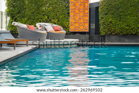 swimming pool with sofa