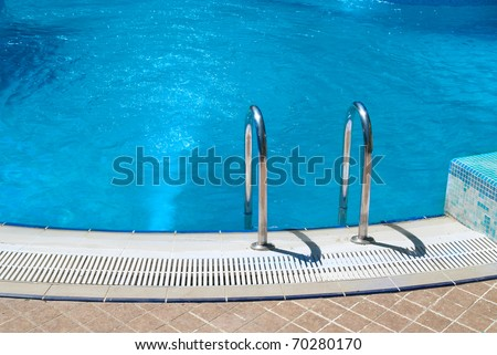 Swimming pool with stair and green relaxing water