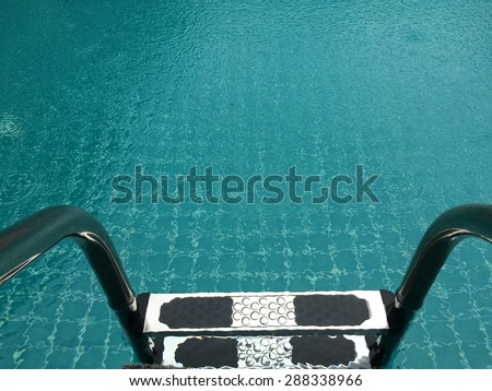 Swimming pool with stair at home close up