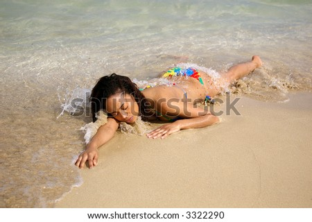 swimsuit girl laying on beach