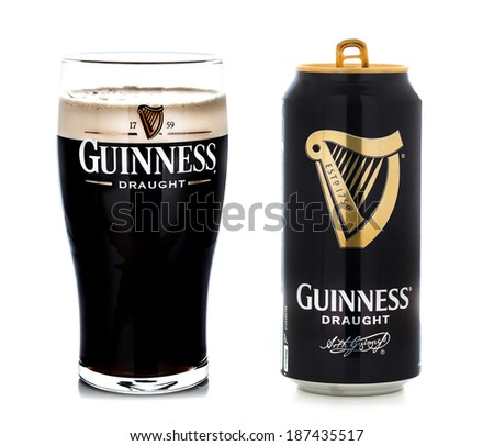SWINDON UK APRIL 15 2014 Pint of Guinness the popular Irish beer on a white background