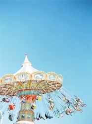 Swing Carousel (Carnival Ride) Set Against a Blue Sky
