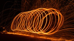 Swing fire Swirl steel wool light photography with reflex in the water long exposure speed motion style ,Beautiful line of fire.