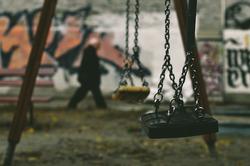 swing in a poor neighborhood