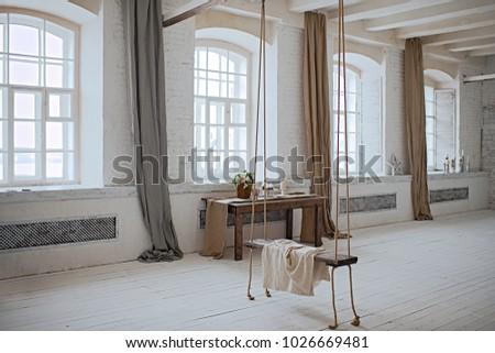 swing in loft interior