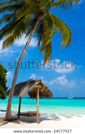 Swing on a tropical beach, vacation symbol - stock photo