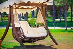 Swinging bench and hammock in the garden