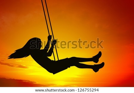 Swinging child silhouette on abstract sunset background