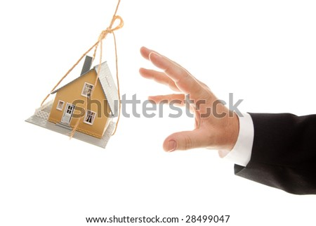 Swinging House and Business Man's Hand Reaching or Pushing Isolated on a White Background.