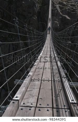 Swinging suspension bridge near Trift glacier