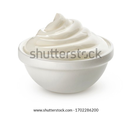 Swirl of sour cream in bowl isolated on white background with clipping path, fresh greek yogurt ストックフォト ©