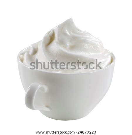 Swirl of whipped cream in a cup