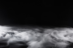 Swirling, Low Lying Fog on Black Background