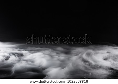 Swirling, Low Lying Fog on Black Background #1022539918