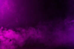 Swirling pink/magenta/purple fog on hazy dark background.