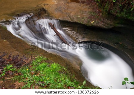 Swirling waters in the Upper Gorge at Old Man\'s Cave in Ohio\'s Hocking Hills have eroded a pothole in the stone stream bed called \